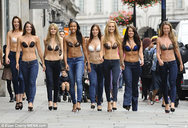 Models parade down London's busy Regent Street wearing their bras to celebrate the UK launch of Lavalia's InvisiBra