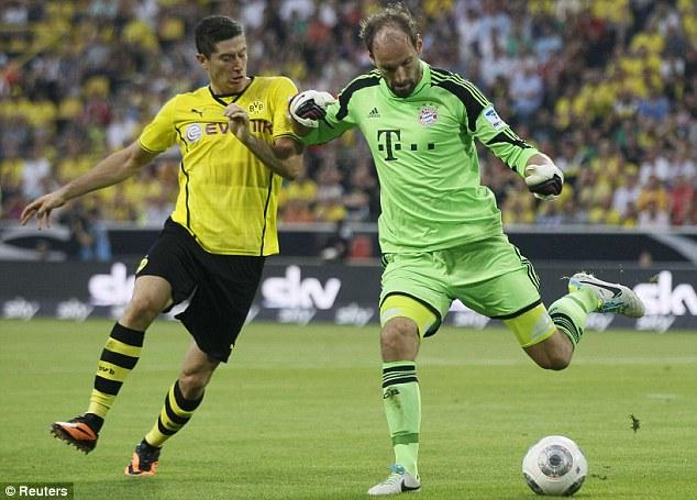 Accuse: Lewandowski (left) insists he wants a move to Bayern despite Dortmund's wishes