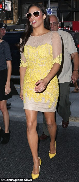 Ray of sunshine: For her appearance on the morning show, Paula wore a nude long sleeve dress with stunning yellow floral embroidery and matching yellow shoes