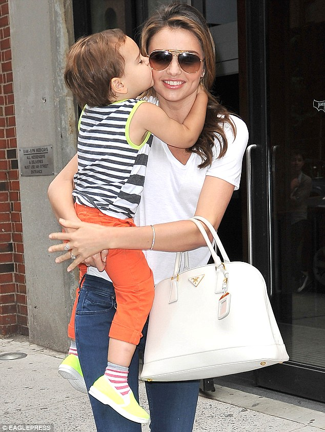 Picture perfect! Miranda Kerr received a big kiss from her son Flynn in New York