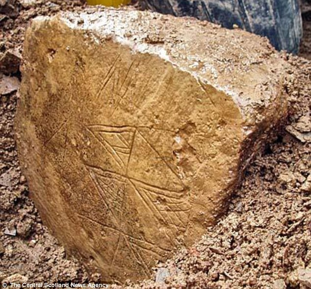 Impressive: The stone art work - which is decorated on both sides and has been described as one of the 'finest ever' to be found in Britain - was uncovered last night on the Ness of Brodgar in Orkney, Scotland