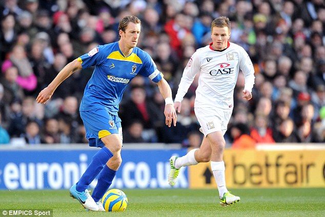 Top scorer: Midson launches an attack in a grudge match with the MK Dons