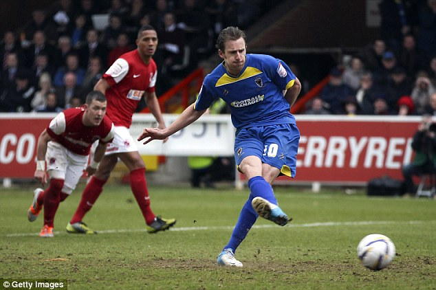 Staying up: Midson scores the crucial penalty against Fleetwood Town to save the Dons from the drop