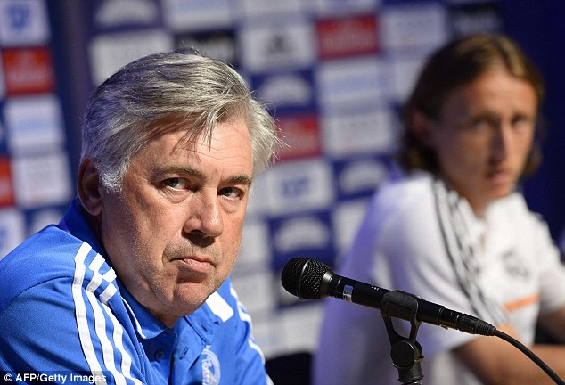 Standing firm: Ancelotti (left) wants to keep Modric at the club and has big plans for him this season