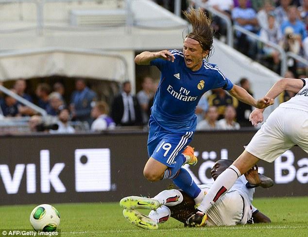 Key man: Luka Modric played for Real Madrid against Paris Saint-Germain last weekend