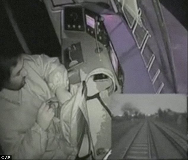 Not paying attention: This driver rooted around in a backpack instead of watching the tracks