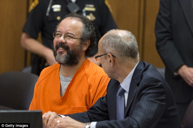 Despicable: Ariel Castro talks with his lawyer during a break in his trial on August 1, 2013 in Cleveland, Ohio. Castro was sentenced to life without parole plus one thousand years for abducting three women between 2002 and 2004