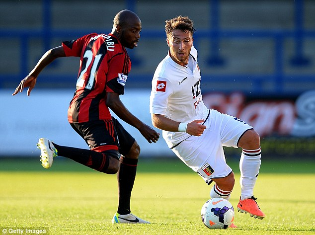 Close fight: Youssouf Mulumbu (left) battles with Bertolacci Andrea in what was an evenly-matched game