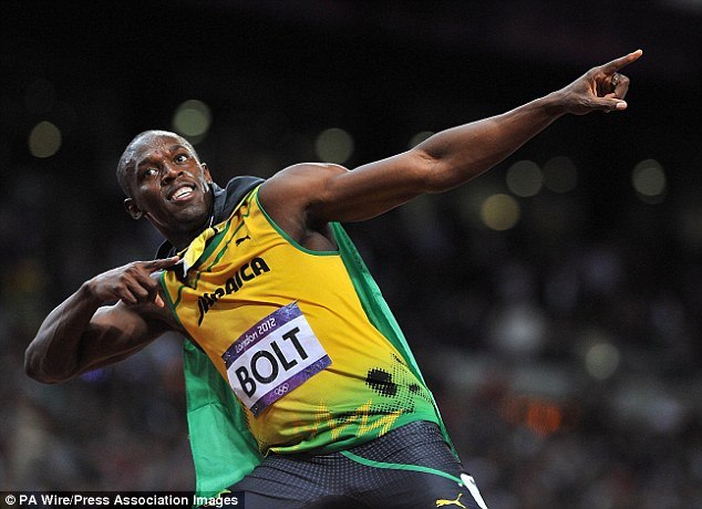 Olympic champion: Bolt strikes his trademark pose after winning the men's 100m final at London 2012