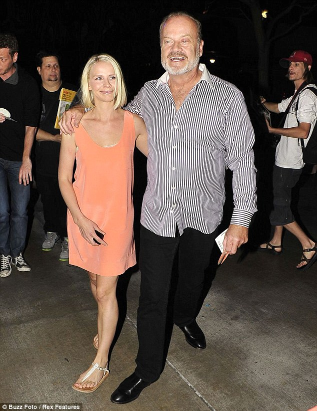 On the other side of Los Angeles: Kelsey Grammer and his wife Kayte Walsh, pictured here at The Rolling Stones concert at The Staples Centre in May this year, are also kicking along nicely
