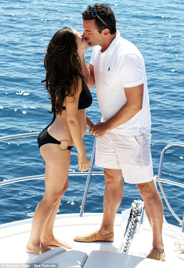 Sealed with a kiss: During the romantic cruise, the couple shared a kiss, with Sean gently caressing his wife's face and holding her hand