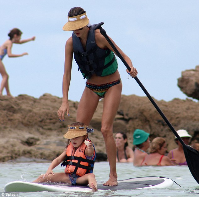Wobble: At one point Alessandra became a little uneasy on her feet and the board nearly flipped, but the doting mother put a protective hand on her little one who managed to keep her balance