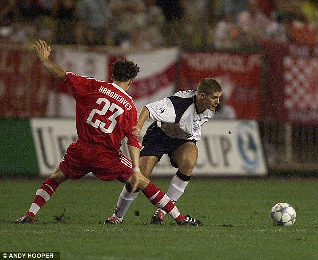 Liverpool man: Gerrard evades the tackle of Bayern Munich's Owen Hargreaves in 2001