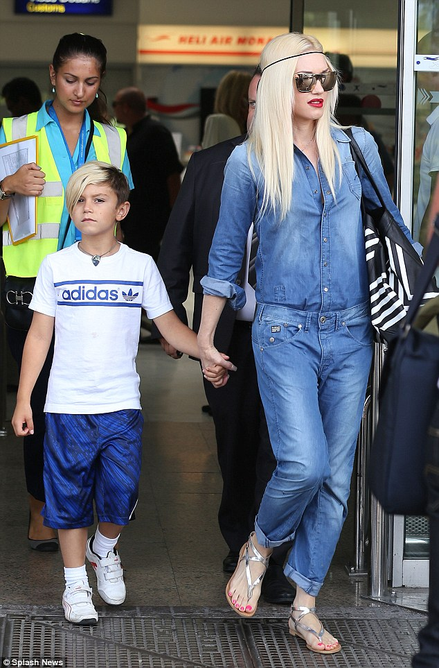 Denim diva: Gwen Stefani travelled with her family to Nice, France wearing a full-body denim worksuit