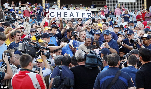 You lie!: Fans let the alleged steroid cheat know how they really felt, both with boos and signs held before, during and after the game