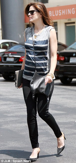 Styled: The actress wore a pair of slim fit black jeans with a striped top that was loose fitting over her bump