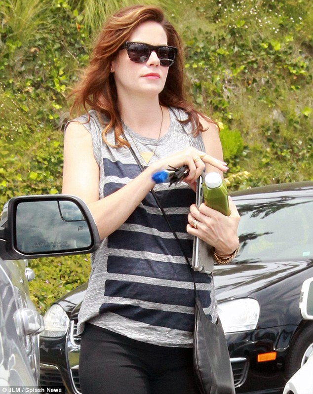 On the go: It looked as if the star was heading to a meeting as she carried her iPad with her and a healthy juice