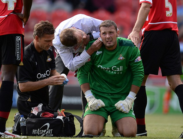 Pain game: Doncaster keeper Ross Turnbull receives attention