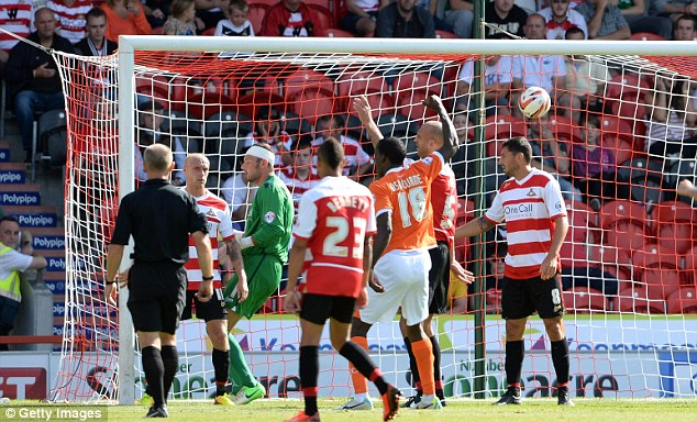 Stealing the points: Gary Mackenzie (not pictured) nods Blackpool ahead late on