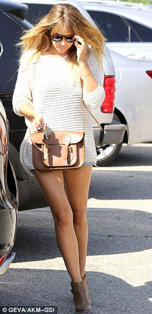 Accessories: Lauren wore a tan handbag and a pair of ankle boots with her over sized jumper