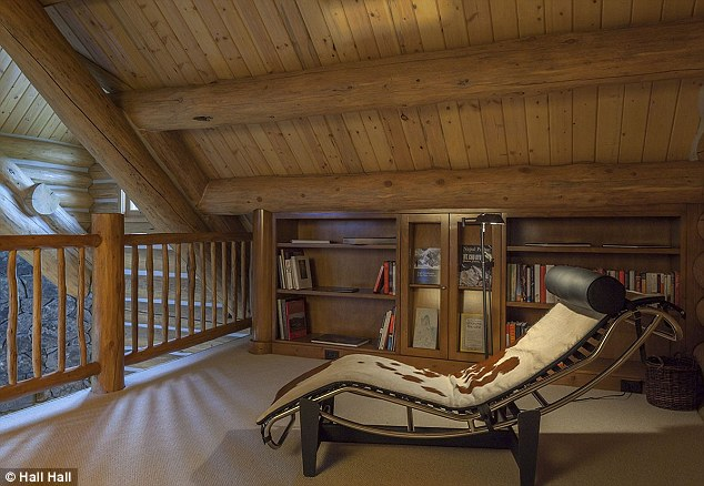 Reading room: A library has been created in the loft space of the cabin