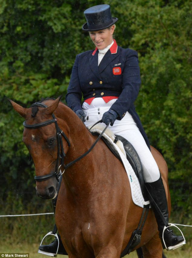 Onlookers said that pregnant Zara looked 'very fit and well' as she performed a dressage trial in the parade ring at Gatcombe