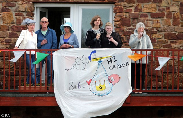 Support: Wellwishers made a banner for Prince Charles visist which read 'Hi Grampa'