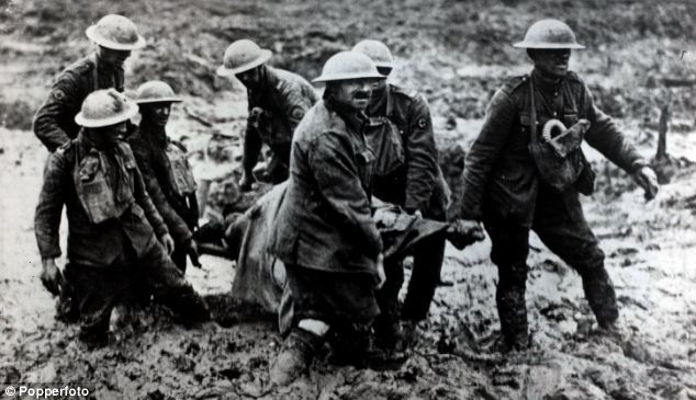 Bravery: British soldiers carry a stretcher in the mud of Passchendaele