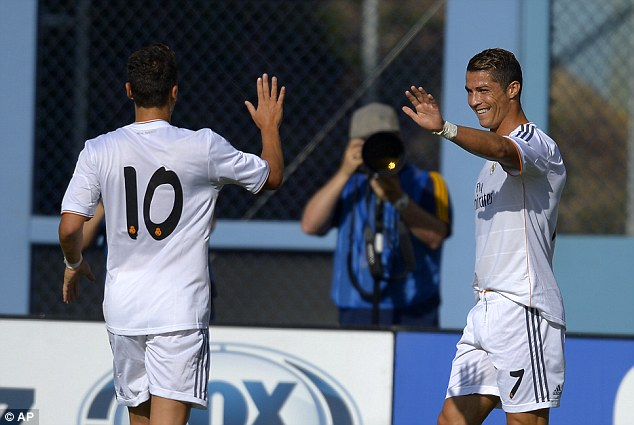 Deadly duo: Cristiano Ronaldo (right) is congratulated by Mesut Ozil after opening the scoring over Everton
