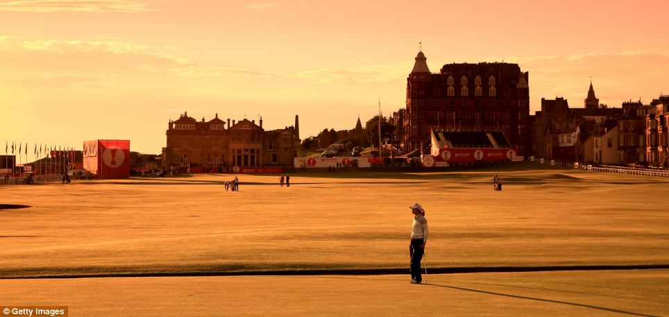 Sunrise: Golfer Paula Creamer completes the first hole on the Old Course at St Andrews at 6.15am in the third round of the 2013 Ricoh Women's British Open
