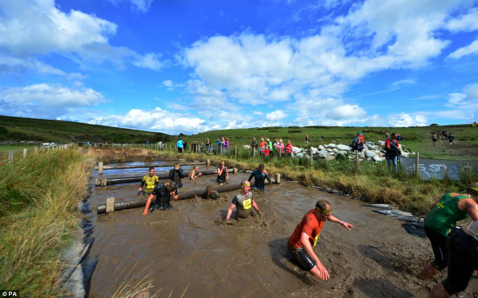 Muddy: Brave competitors took part in the Total Warrior 10 Mile Challenge at Shap Abbey, Cumbria, under sunny skies