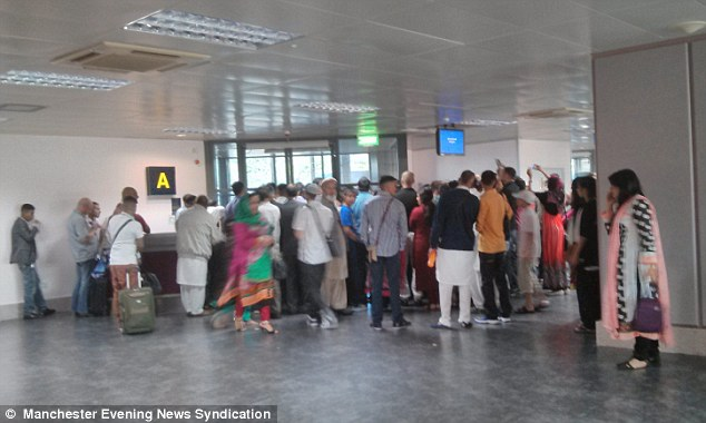 Waiting game: The Airblue flight was due to fly from Manchester Airport to Islamabad in Pakistan, at 9.50pm on Friday - but passengers were fed chips and beans to keep them going during the delays