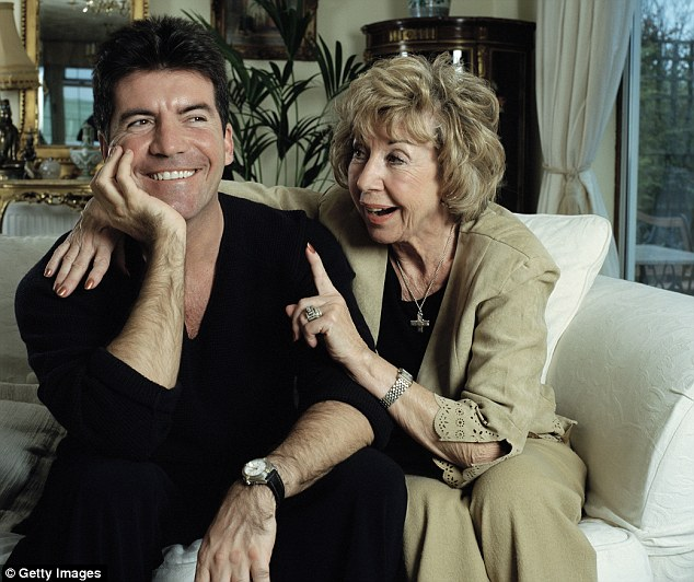 Mummy dearest: Cowell is also said to be flying back to the UK in the next few days to see his mother Julie to discuss the pregnancy news