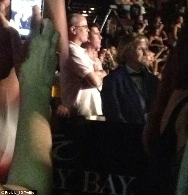 Putting the drama behind him: Cowell was pictured at a One Direction concert in Las Vegas on Saturday night