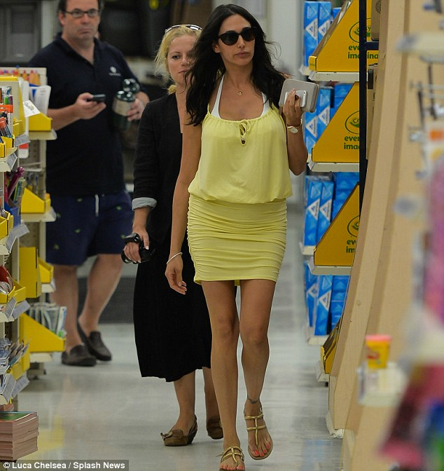 Keeping a low profile: Lauren displayed the tiniest hint of a bump in the tight dress