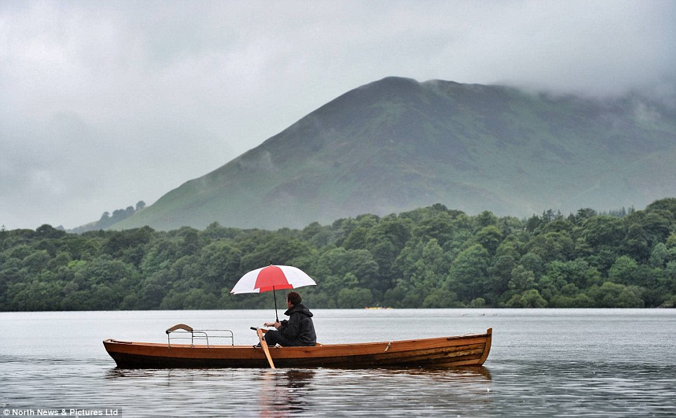 Great weather for ducks: There was a return to a typical British summer weather today in the Lake District where visitors resorted to umbrellas in boats