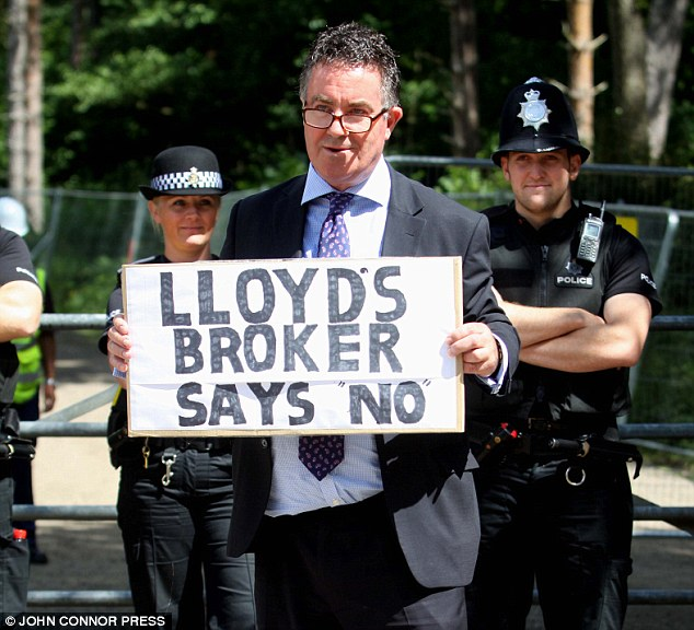 Local resident and Lloyds of London broker Peter Spencer makes his feelings known outside the gates of the Cuadrilla fracking drilling site