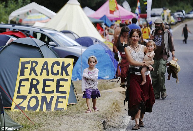 Frack free zone: Young families were pictured walking through the roadside camp at the entrance gate to the site near Balcombe