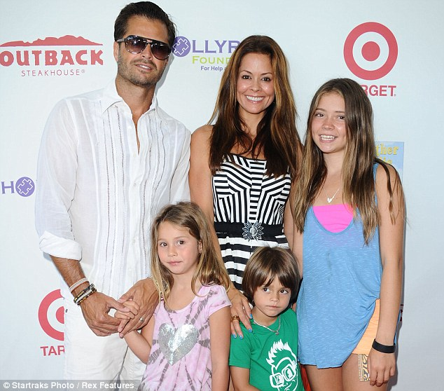 Family affair: Brooke, pictured here with her husband, David Charvet, and her three of her children on August 2012 in Los Angeles, Calif., visited Mexico in June as an ambassador for Operation Smile