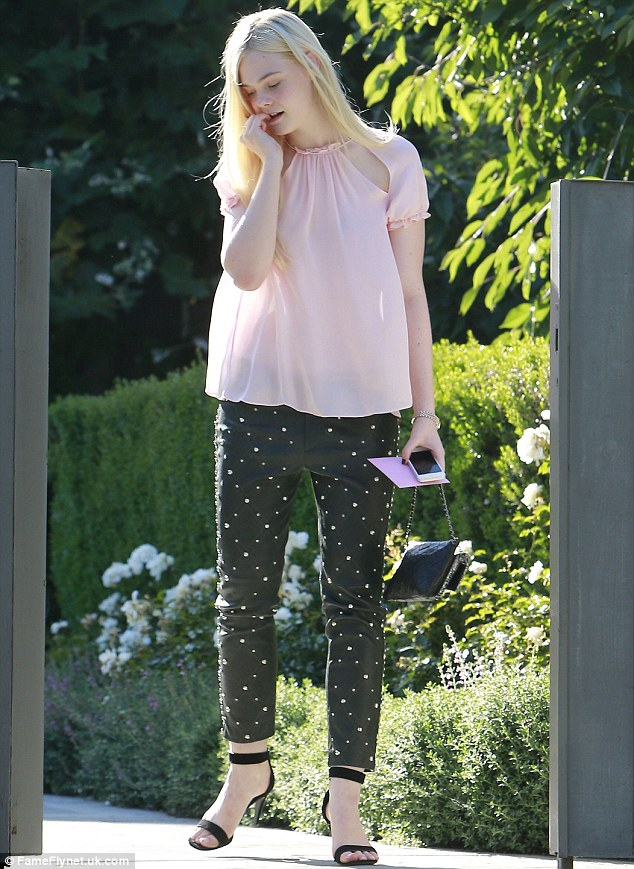 Fun fashion: Elle Fanning was seen in a pair of studded trousers as her mother dropped her at a friend's house on Sunday
