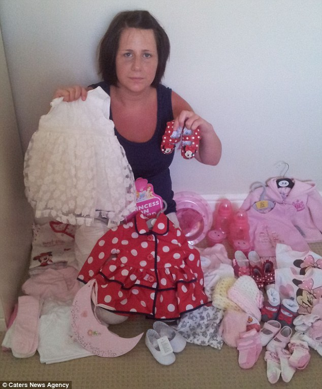 Pretty in pink: Sarah Sharples and partner Lee were told by doctors they were expecting a baby girl so spent £3,000 on pretty baby essentials... but then she gave birth to a little boy and is now stuck with a wardrobe full of pink clothes