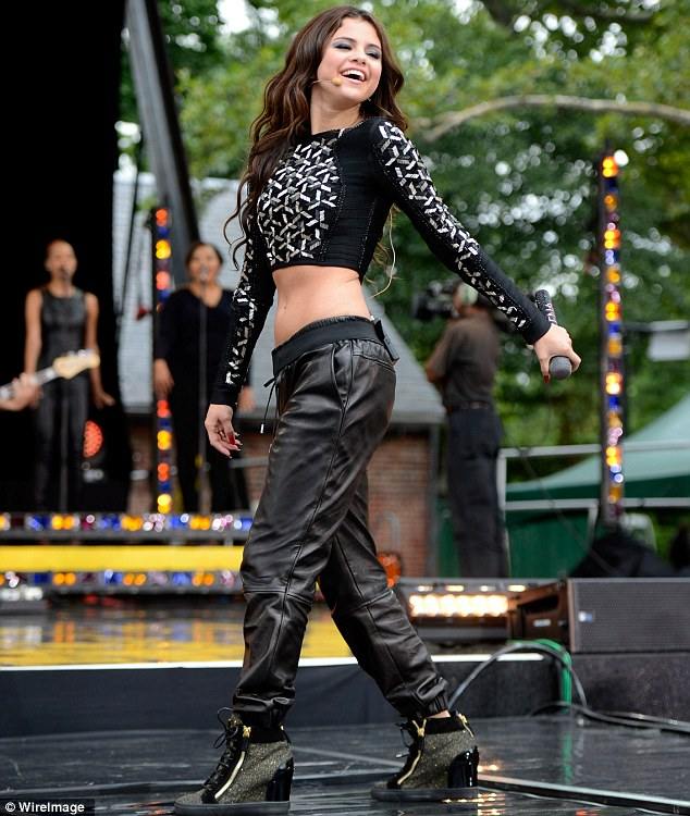Fun: On stage Selena isn't shy about showing some skin, pictured here playing in New York in July