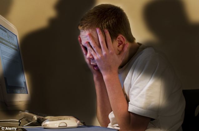 Despair: Childline was contacted on more than 4,500 occasions by cyber bullying victims last year - around 12 a day (file picture)