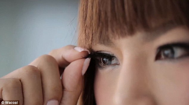The big reveal: Eventually the woman takes off her eyelashes and removes her make-up