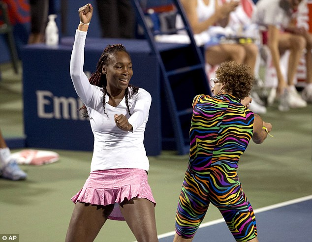 """In the spirit: Venus Williams dances with dance motivator """"Spandy Andy"""" in Toronto"""