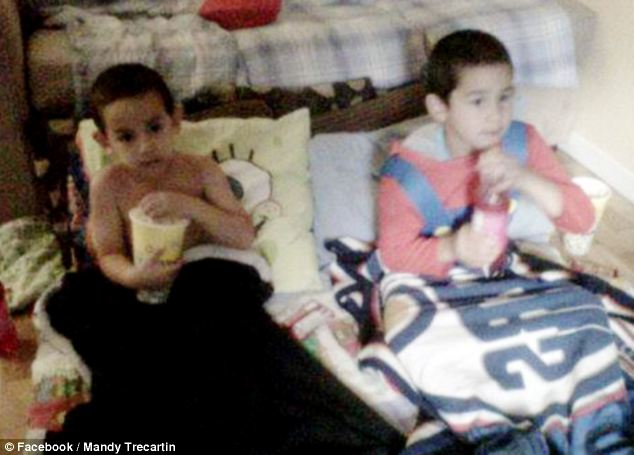Missed: The young boys were killed as they slept on the floor in the apartment above the pet store