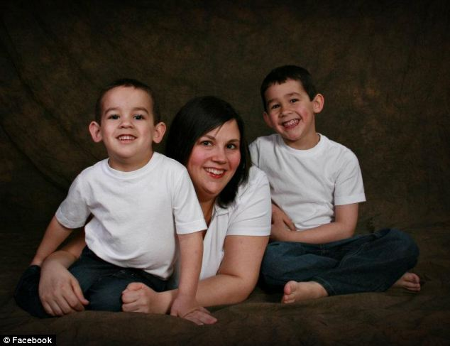 Heartbroken: Mandy Trecartin poses with her two sons, seven-year-old Connor and five-year-old Noah, who were apparently strangled to death by a python as they slept above a pet shop