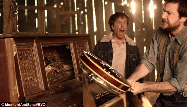 Banjoed: Bateman swings for the fences with his instrument as Helms screams wildly in the background