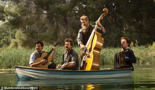 Don't sink! The parody band takes to the still waters of a pond to rock out on their instruments
