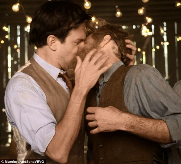What would Phil Hartman say? SNL alumni Jason Sudeikis and Will Forte lock lips in the new Mumford and Sons video